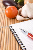 Vegetable and pad with pen — Stock Photo