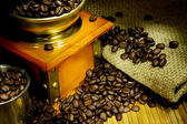 Grinder,coffee beans, pot on sacking — Stock Photo