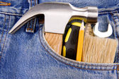 Tools and instruments in jeans — Стоковое фото