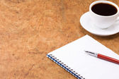 Coffee and ink pen pad — Stock Photo