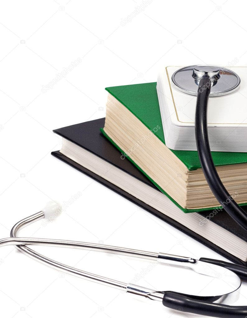 Several books and stethoscope on white  Stock Photo #12112818