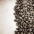 Coffee beans and paper texture — Stock Photo