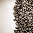 Coffee beans and paper texture — Stock Photo #12282231