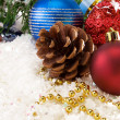 Christmas ornament and fir tree on snow — Stock Photo