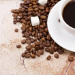 Stock Photo: Cup of coffee and beans on texture