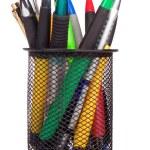 Holder basket full of colorful pens isolated on white — Stock Photo