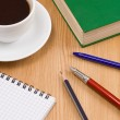 Coffee, book, pen with notebook on table — Photo