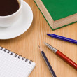 Coffee, book, pen with notebook on table — Stock Photo