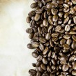 Stock Photo: Coffee beans on paper texture