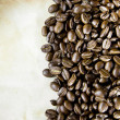 Coffee beans on paper texture — Stock Photo
