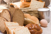 Bakery products and basket on sack — Stock Photo
