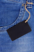 Price tag over jeans textured pocket — Stok fotoğraf