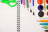 Pencils, felt pens, paint brush and scissors on paper — Stock Photo
