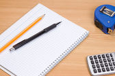 Tape measure and notepad — Stock Photo