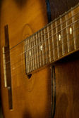 Guitar on black background — Stock Photo