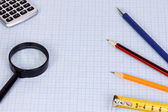 School accessory and magnifier — Stock Photo