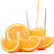 Tasty orange and outpouring juice — Stock Photo