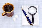 Magnifying glass at paper — Stockfoto