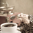 Cup of coffee, beans, pot and grinder on wood — Stock Photo