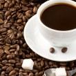 Stockfoto: Cup of coffee and spoon on roasted beans