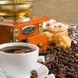 Stock Photo: Cup full of coffee, beans, pot and grinder