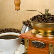 Coffee beans, cup and grinder on wood — Stock Photo