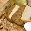 Stock Photo: Bakery products and grain on wood