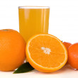 Juice in glass and oranges on white — Stock Photo