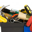 Tools and instruments in black plastic box - Stock Photo