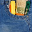 Tools and instruments in jeans pocket — Stock Photo #12343795