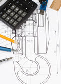 Pen and pencil, calculator on drafting — Stock Photo