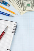 School accessories and notebook on graph grid paper — Stock Photo