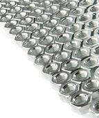 Metal nuts on white — Stock Photo