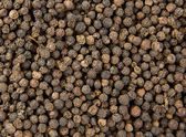 Black pepper grain as background — Foto Stock