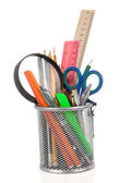 Set of school accessories in holder on white — Stock Photo
