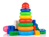 Colorful plastic toys and bricks on white — Stock Photo