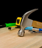 Hammer and other tool on wood — Stock Photo