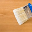 Paintbrush painting on wood board — Stock Photo #12403773