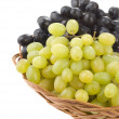Fresh grape fruits and wicker basket plate — Stock Photo #12403816