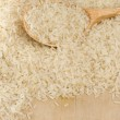 Raw rice seed and spoon — Stock Photo
