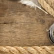 Stock Photo: Ship ropes and compass with feather on wood