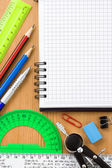 Back to school and supplies near checked notebook — Stock Photo