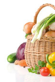 Healthy vegetable food and basket — Stock Photo