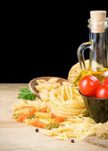 Pasta and food ingredient isolated on black — Stock Photo