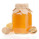 Jar of honey and lemon isolated on white — Stock Photo