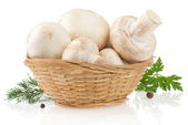 Mushrooms and basket with spices isolated on white — Stock Photo