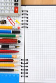 Back to school concept and checked notebook on wood background — Stock Photo