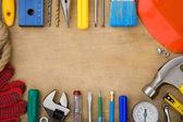 Set of tools on wood background — Stock Photo