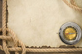 Ropes and compass at old vintage ancient paper — Stock Photo