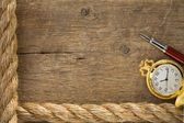 Ship ropes and watch with ink pen on old wood — Stock Photo